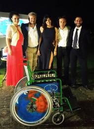 presentazione della carrozzina alla Cena di Gala di Spingi lo Sport